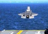 """Samolot myśliwski w wersji krótkiego startu i pionowego lądowania STOVL Lockheed Martin F-35B """"Lightning II"""" startuje z okrętu desantowego USS Wasp (LHD-1) podczas prób morskich na Oceanie Atlantyckim. 5.10.2011 r. (Źródło: US Navy)."""
