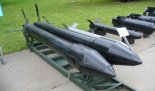 Pocisk rakietowy w wersji S-25OF z głowicą odłamkowo- burzącą. (Źródło: Wikimedia Commons).