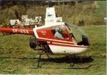 Lekki śmigłowiec Robinson R-22B (SP-GSA). (Źródło: Zdjęcie pochodzi z Archiwum UM Świdnik i Stowarzyszenia Forum Świdnika- http://www.historia.swidnik.net/).
